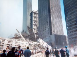 Emergency personnel attempt to scale the ruins of the North Tower