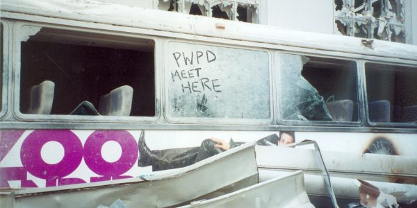 A destroyed MTA bus near the site of Ground Zero served as an impromptu meeting place for PWFD firefighters