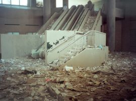The interior of a structure near Ground Zero - piles of paper, dust and debris littered staircases and escalators
