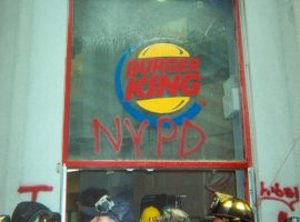 A Burger King near the site of Ground Zero became the temporary headquarters of the NYPD officers in the area, indicated by the red spray painted message on the building's entrance