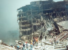 Another building destroyed in the fall of the Twin Towers appears to be melting as it collapses