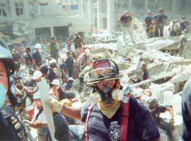 PWFD firefighters in respirators, masks, and other protective gear work with other emergency personnel to clear debris at the Ground Zero site