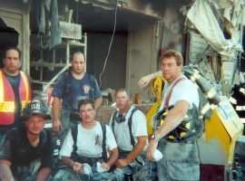 A group of six men, including PWFD firefighters, rest before returning to work clearing rubble at Ground Zero