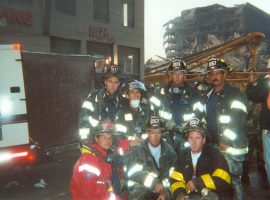 Seven uniformed members of the PWFD pose for a photo just outside of the Burger King serving as the temporary headquarters for NYPD